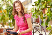 Girl with touchpad — Stock Photo
