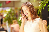 Shopping girl talking on the phone — Stock Photo