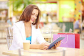 Shopping girl using touchpad — Stock Photo