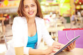 Attractive shopper with touchpad — Stock Photo