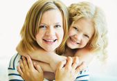 Woman embraced by her daughter — Stock Photo