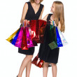 Mother and daughter looking purchase — Stock Photo #13296539