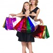 Mother and daughter in elegant dresses with many colorful bags — Stock Photo #13296550