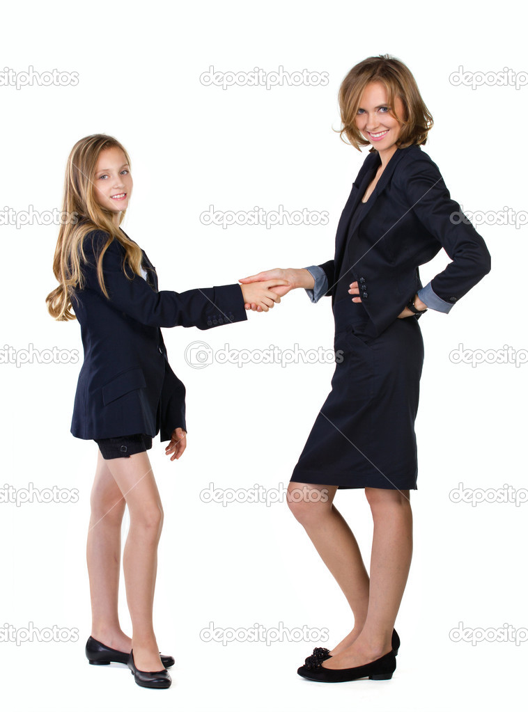 Businespartners mother and daughter looking at camera isolated on white — Stock Photo #13296588