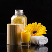 Aromatherapy with liting candles sea salt towel and flower — Stock Photo