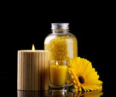 Spa still-life with candles sea salt and flower — Stock Photo