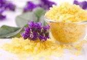 Violetes and bath salts — Stock Photo
