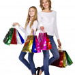 Mother and daughter in clothing sportive style with many bags — Stock Photo