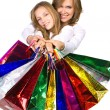 Mother and daughter go shopping - Stock Photo