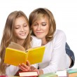 Mother and daughter reading books — Stock Photo