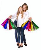 Madre e hija en camisa y jeans con muchas cajas — Foto de Stock