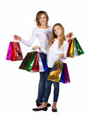 Mother and daughter in jeans and shirt with many box — Стоковое фото