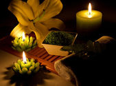 Spa still-life with candles, cosmetics, flowers — Stock Photo