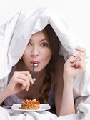 Girl on diet eating spoon — Stock Photo