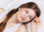 Beautiful woman asleeping in a bed — Stock Photo