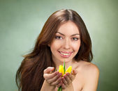 Beautiful young women with tulip — Stock Photo