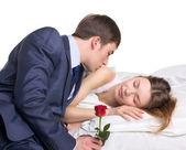 Man, woman and red rose — Stock Photo