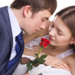 Man present a rose to girl - Stock Photo