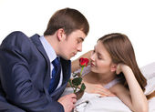 Man, woman and red flower — Stock Photo