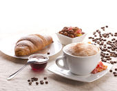 Breakfast with coffe and croissant — Stock Photo