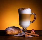Latte macchiato with croissant — Stock Photo