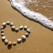 Heart on a beach - Stock Photo