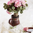 Bouquet of flowers in a jug — Stock Photo
