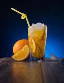 Refreshing cocktail with orange and ice — Stock Photo
