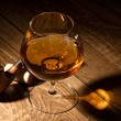 Glass with brandy and tobacco pipe - Stock Photo