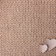 Handmade knit texture with hearts - Stock Photo