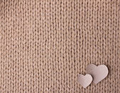 Handmade knit texture with hearts — Stock Photo