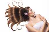Beautiful woman with healthy long hair. — Stock Photo