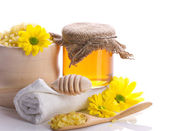 Spa accessories, flowers and honey — Stock Photo
