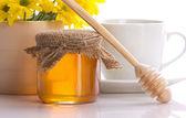 Honey, tea and flowers — Stock Photo
