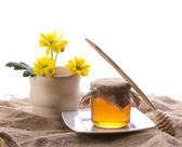 Rural style with honey and flower — Stock Photo
