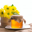 Rural still, honey and bunch of flowers — Stock Photo