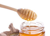 Closeup of honey and drizzler — Stock Photo