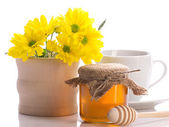 Still of honey, flowers and cup — Stock Photo