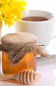Closeup of honey, tea and flower — Stock Photo