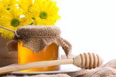 Closeup still of honey and flowers — Stock Photo
