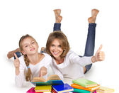 Mother and daughter couching reading books — Stock Photo