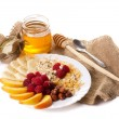Stock Photo: Still life with honey, fruits nuts and flakes