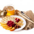 Still life with honey, fruits nuts and flakes — Stockfoto