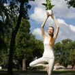 Woman standing in tree pose — Stock Photo