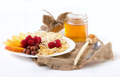 Light breakfast with fresh fruits and honey — Stock Photo