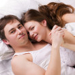 Stock Photo: Young man and woman in a bed