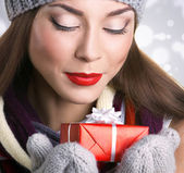Beautiful woman with gift — Stock Photo