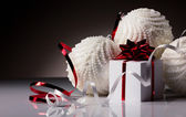 Christmas bals with gift box — Stock Photo