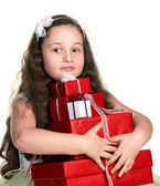 Little girl with gifts — Stock Photo