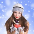 Young woman with  gift box — Lizenzfreies Foto